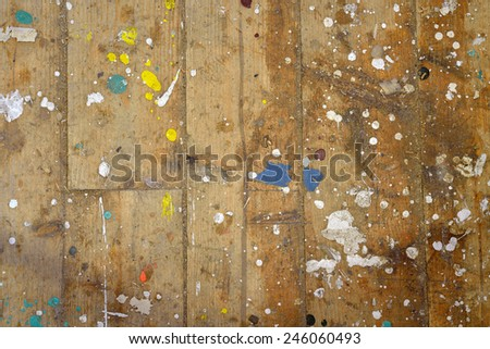 Colorful boat paint droplets on a pine wood plank woodshed floor - stock photo