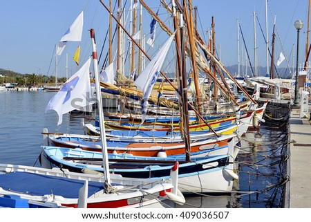 Colorful boats in the port of Sanary-sur-Mer, commune in the Var department in the Provence-Alpes-Cote of Azur region in southeastern France. - stock photo