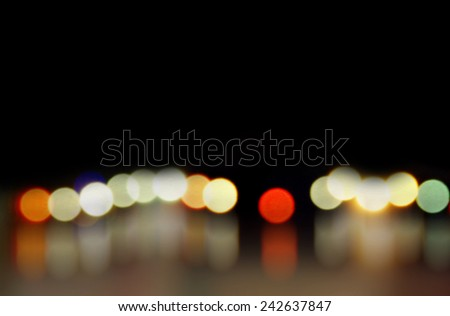 Colorful bokeh reflecting on water,holiday festival  - stock photo