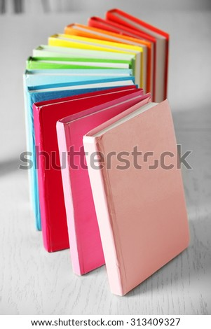 Colorful books on table in room - stock photo