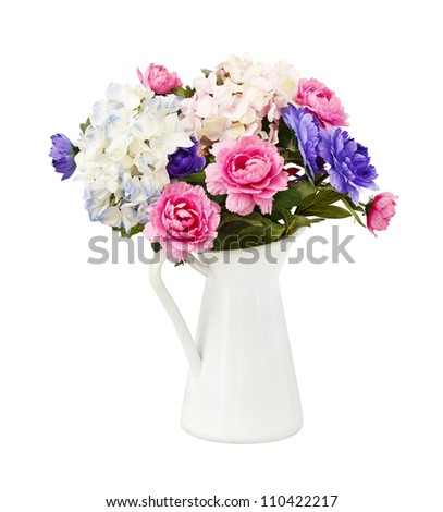 Colorful bouquet pink and blue flowers in white decorative bucket, isolated on white - stock photo