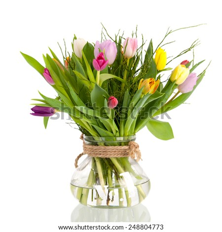 colorful bouquet tulips in glass vase isolated over white background - stock photo