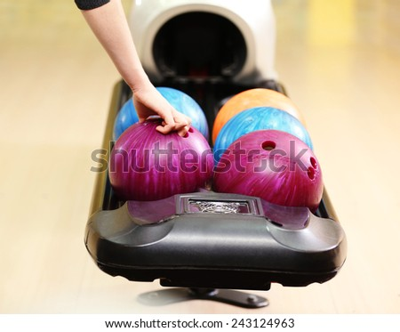 Colorful Bowling balls in ball return - stock photo