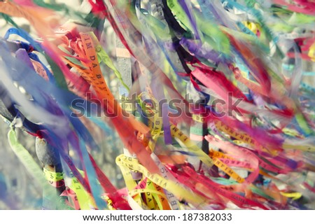 Colorful Brazilian wish ribbons fluttering in the wind at Bonfim Church Salvador Bahia Brazil - stock photo