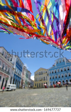 Colorful Brazilian wish ribbons waving in the sky above colonial architecture of Pelourinho Salvador Bahia Brazil - stock photo