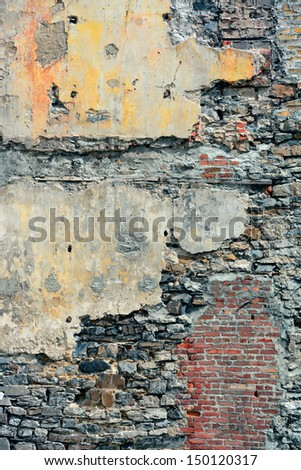 Colorful brick wall background from old building in Quebec City - stock photo