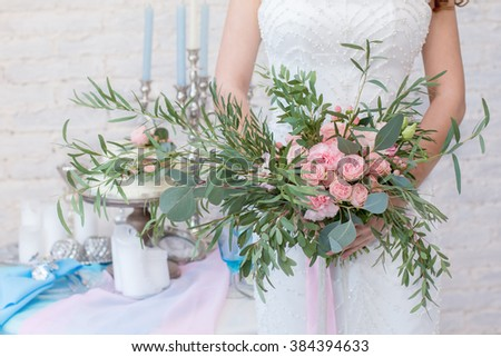 Colorful bridal bouquet. Wedding bouquet for bride. Bride with bouquet, closeup. Beautiful wedding bouquet in hands of the bride. Beautiful wedding bouquet in bride's hand. Wedding Bouquet of Peonies - stock photo