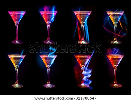 Colorful Bright fresh modern cocktails in glasses on black background with reflection - stock photo
