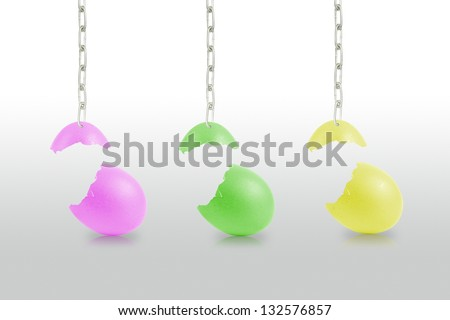 Colorful Broken eggs hanging by chains isolated on the white background - stock photo