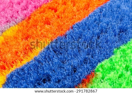 Colorful brooms closeup picture. - stock photo