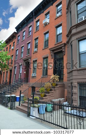 Colorful Brownstone Home Trash Cans in Gated Area Urban Residential Neighborhood Brooklyn New York - stock photo