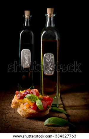 Colorful bruschetta appetizer on a low key background suitable for many food service promotions. - stock photo