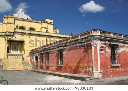 Colorful buildings are the hallmark of the ancient Catholic city of Antigua in Guatemala - stock photo