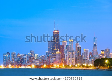 Colorful buildings in downtown Chicago during sunset with clear blue sky - stock photo