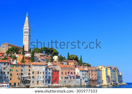 Colorful buildings of an old Venetian town and tall belfry of Romanesque church near the Adriatic sea, Rovinj, Croatia - stock photo