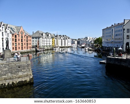 Colorful Buildings on a canal in Alesund, Norway - stock photo