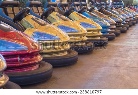 Colorful bumper cars in a row - stock photo