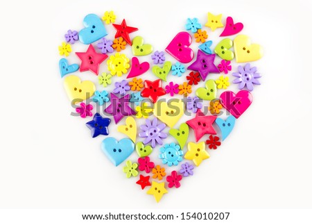 Colorful buttons in the shape of a heart on a white background - stock photo