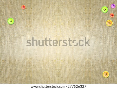 colorful buttons over brown grungy canvas parchment background. Backdrop, invitation card design idea template wallpaper. Decoration, ornament, layout, artistic design. - stock photo
