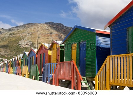 Colorful cabins on a white sand beach in South Africa - stock photo