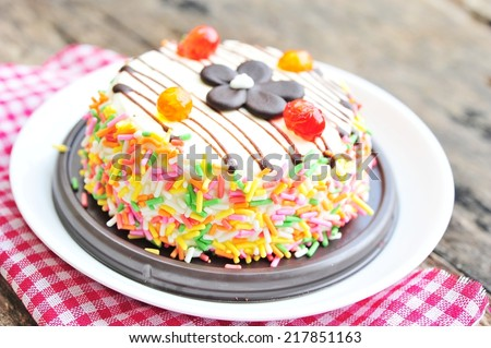 Colorful cake frosting with sugar sprinkles - stock photo