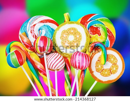 Colorful candies and sweets in the background of balloons - stock photo