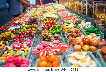 Colorful candies and sweets on a fair market - stock photo