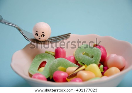 Colorful candies in glass bowl - stock photo