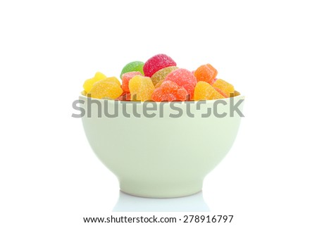 Colorful candies in glass bowl isolated on white - stock photo