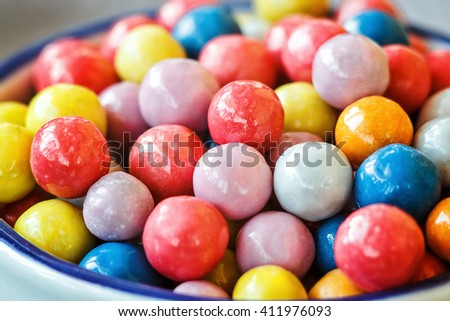 Colorful candies in jar on table in shop, closeup. - stock photo