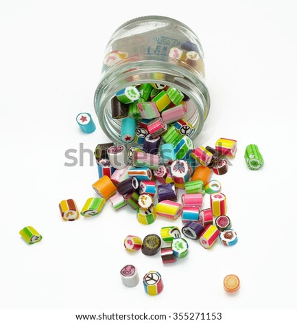 Colorful candies in jar on white background - stock photo