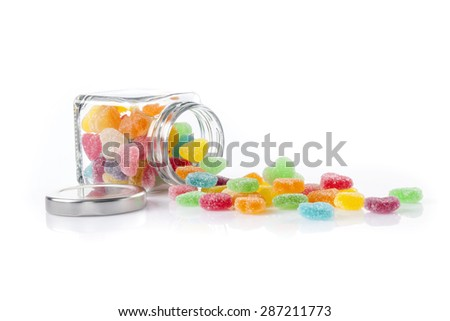 Colorful candies isolated on white - stock photo