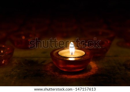 colorful candles in the glass - stock photo