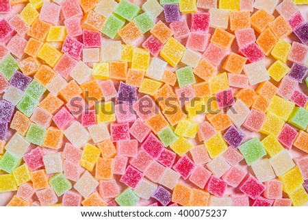 Colorful candy and jelly on pink background - stock photo