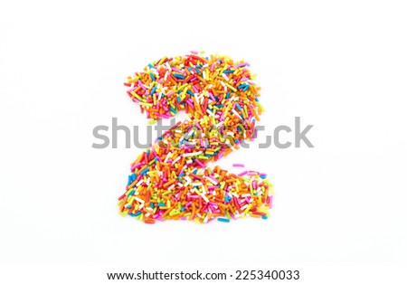 Colorful candy sprinkles number two isolated on white background - stock photo