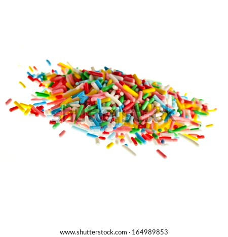 Colorful candy sprinkles pile hill solated on white background - stock photo
