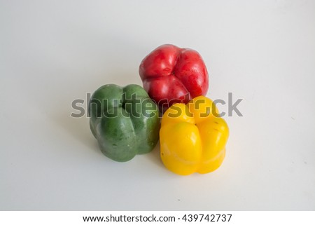 Colorful capsicum bell pepper sliced and whole isolated on white background - stock photo