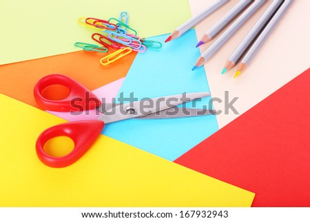 Colorful cardboard and scissors close-up - stock photo