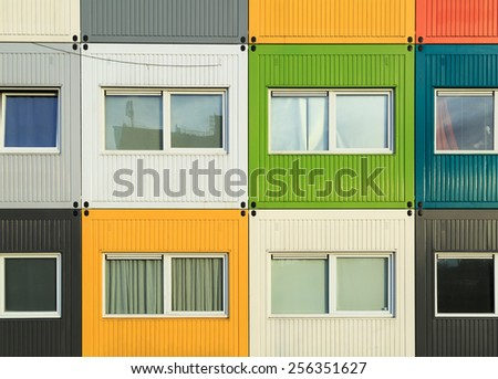 Colorful cargo Containers apartments for students, to help solve housing problems. - stock photo
