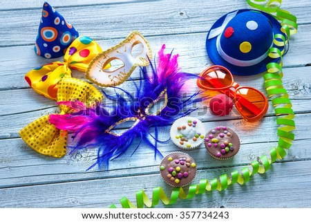 Colorful carnival background with party accessory, streamers and confetti - stock photo