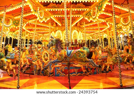 colorful carousel with lights at night - stock photo