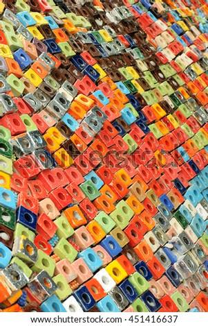 Colorful ceramic cube art blocks with circle hole at public park, Ratchaburi, Thailand.  - stock photo