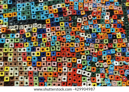 colorful ceramic cube art blocks with circle hole, feel like background and texture on large wall. - stock photo