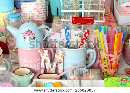 Colorful ceramic dishware and cutlery in pastel colors - stock photo