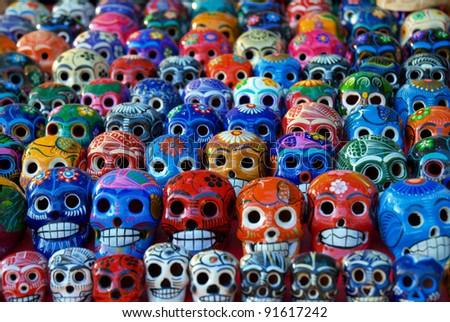 Colorful ceramic skulls for sale at Chichen-Itza, Mexico - stock photo