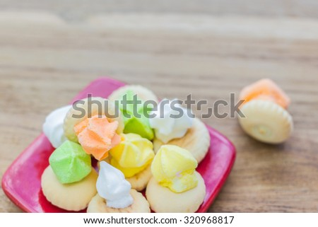 Colorful cereal and some loose cereal. The cereal are of variety - stock photo