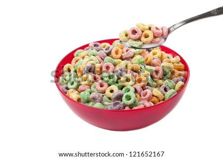 Colorful cereal bowl with a spoon against white background - stock photo