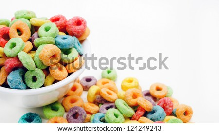 Colorful cereal on white background - stock photo
