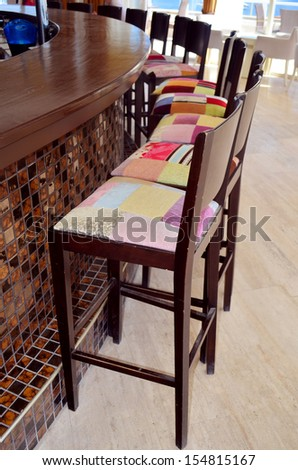 colorful chairs in row in bar  - stock photo