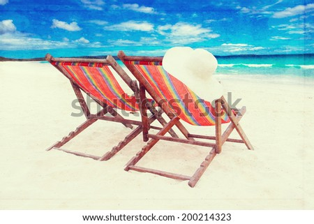 colorful chairs on the white sand beach. vintage retro style effect - stock photo